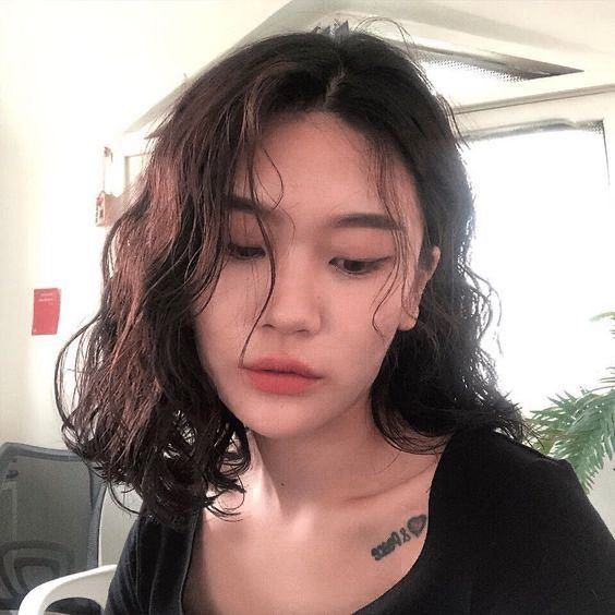 Long hair curly screaming asian