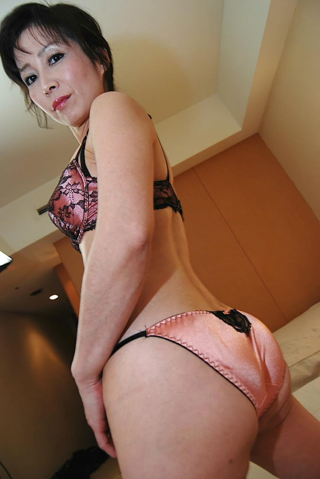bending knowingly over milf Asian